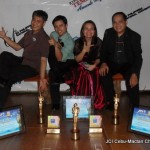 2009 NATIONAL AWARDS HAUL. 2009 President Emi Rose R. Parcon, as flanked by her successor 2010 President-elect Marlon Ariel L. Polinar and predecessor and husband, 2007 President Angelo Daniel R. Parcon, shows the awards JCI Cebu-Mactan Channel earned during the 61st National Convention in Puerto Princesa City, Palawan. With them (at left) is JCI Sen. Gleendo B. Dasmariñas, CNT, 2009 national chair for records and recognition.